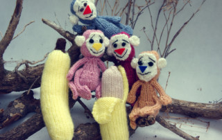 2016, year of monkey, symbol of intelligent, lucky, agile, group of handmade monkey on branch of tree with banana, knitted toy as stuffed animal make from yarn,  hand made product on white background